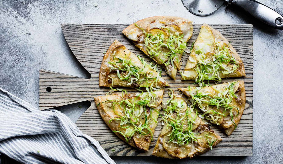 Roasted Potato Pizza with Shaved Brussels Sprout Slaw by Snixy Kitchen