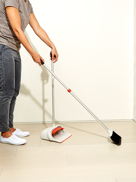 living room cleaning: sweep the floors