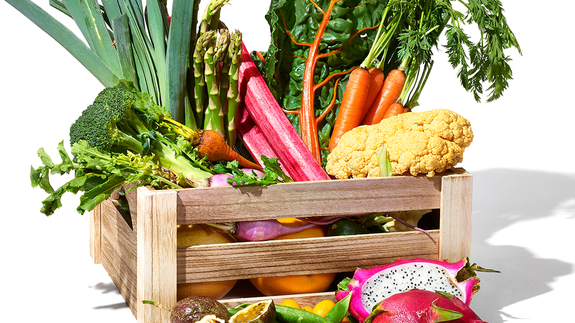 crate of spring fruits and vegetables