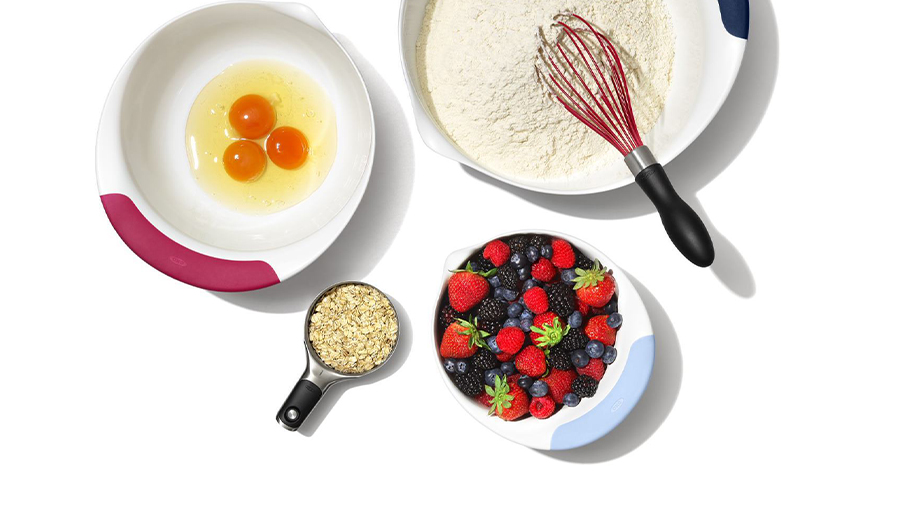 mixing bowls with eggsflour and fruit