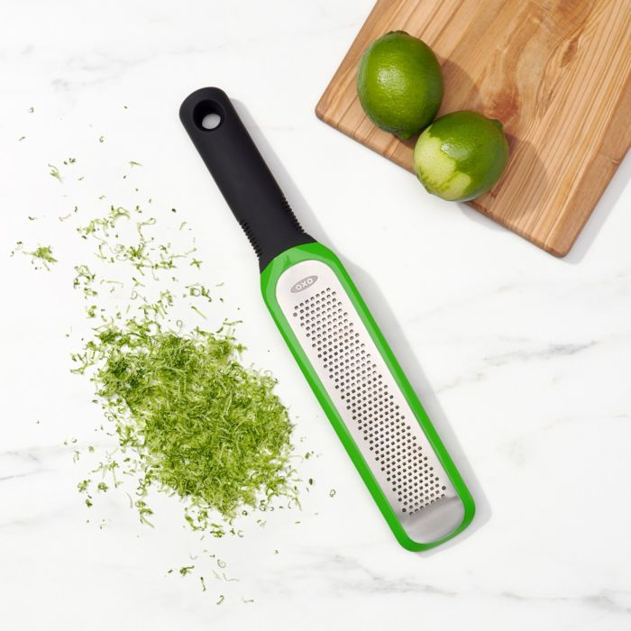 OXO Good Grips Etched Zester alongside limes and lime zest