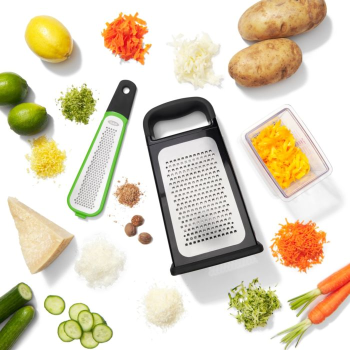Etched Box Grater With Removable Zester surrounded by produce ad cheese
