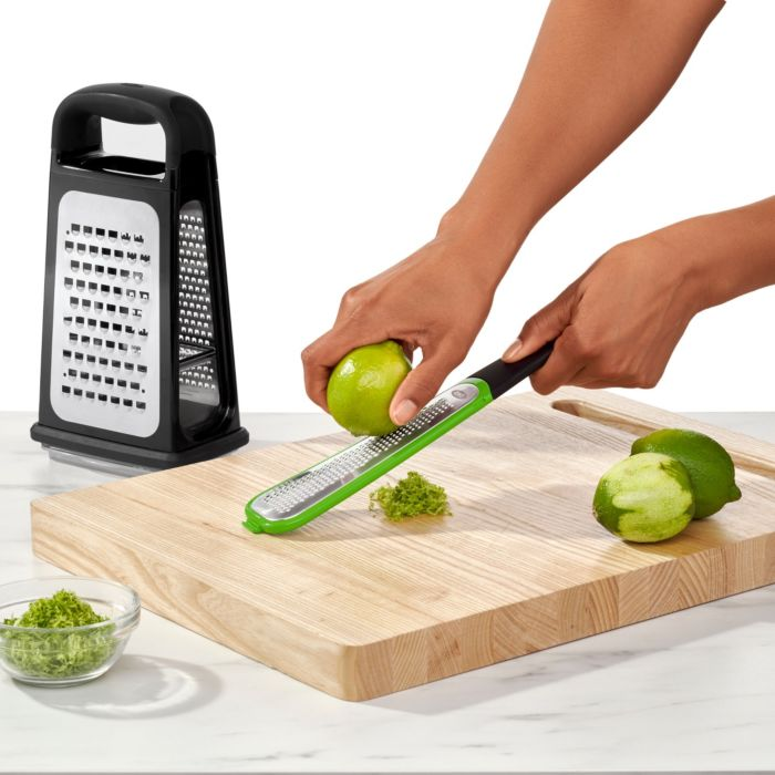Person zesting lime with Zester removed from Etched Box Grater