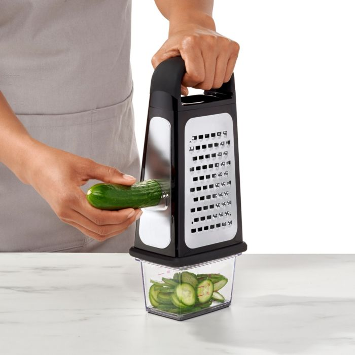 Person slicing cucumber on side of Etched Box Grater With Removable Zester