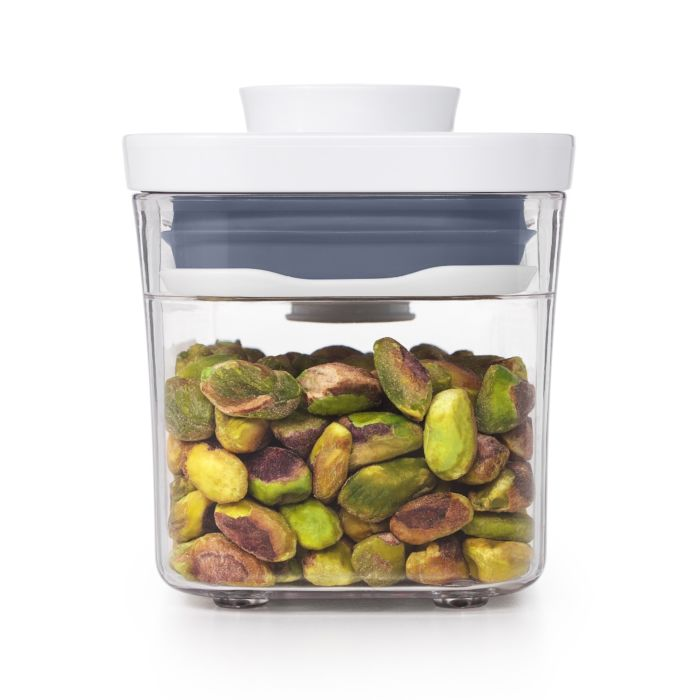 Side view of OXO POP Container, Slim Rectangle Mini 0.4 qt. with shelled pistachios