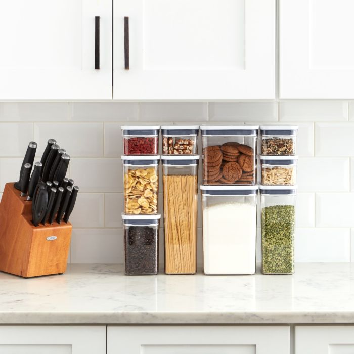 OXO 10 Piece POP Container Set filled with snacks, pasta, nuts, grains and flour on a countertop