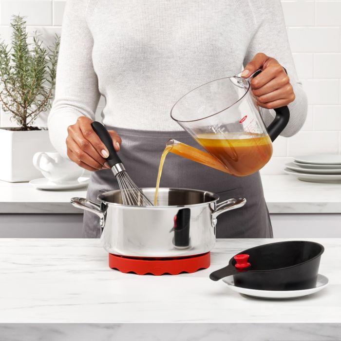 Person pouring gravy into pot with OXO Good Grips 4 Cup Fat Separator
