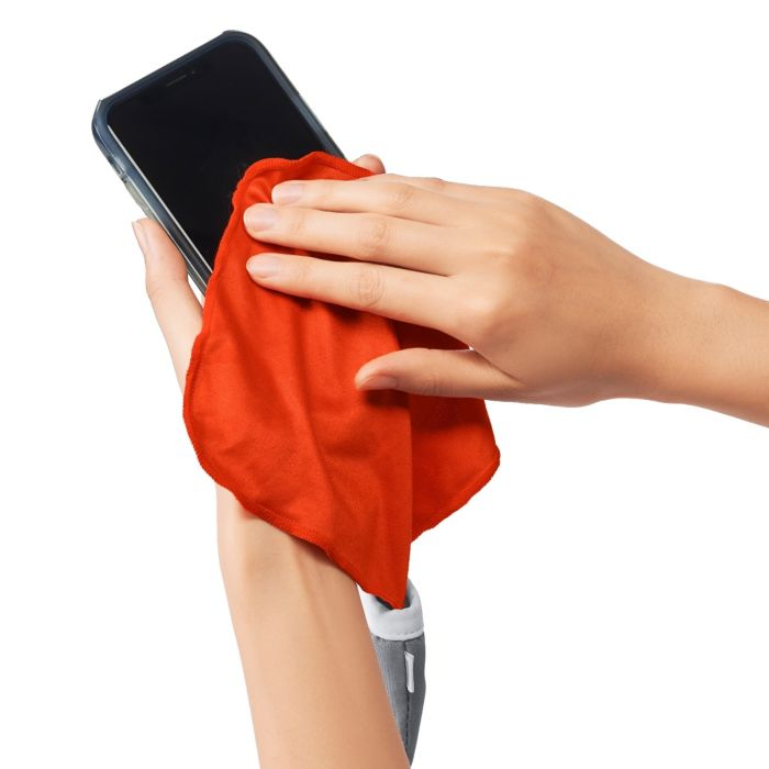 Microfiber cloth  from OXO Keyboard & Screen Deep Cleaning Set cleaning a smartphone