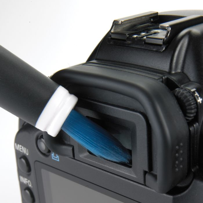 Electronics Cleaning Brush being used on a camera