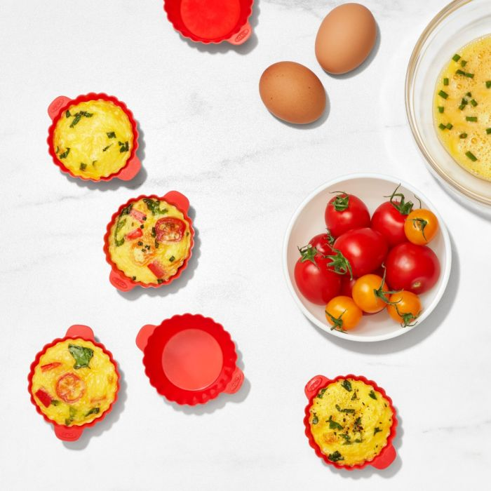 Egg bites in OXO Good Grips Silicone Air Fryer Cups next to ingredients