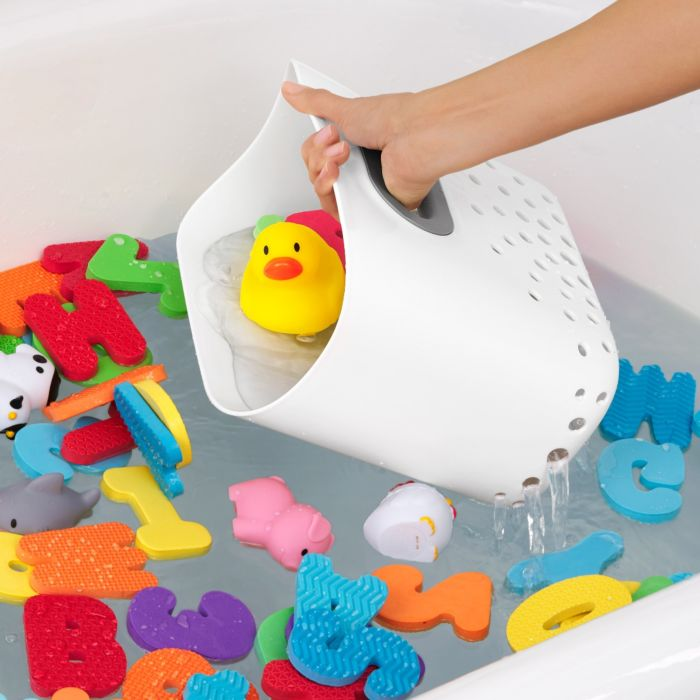 OXO Tot Stand Up Bath Toy Bin scooping up toys in bath tub
