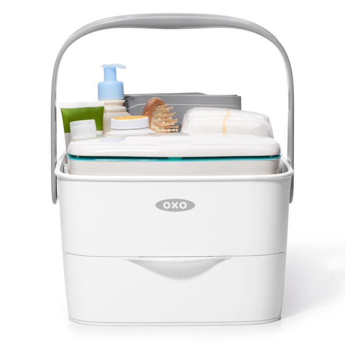 Front view of OXO Tot Diaper Caddy with Changing Mat and diaper-changing essentials