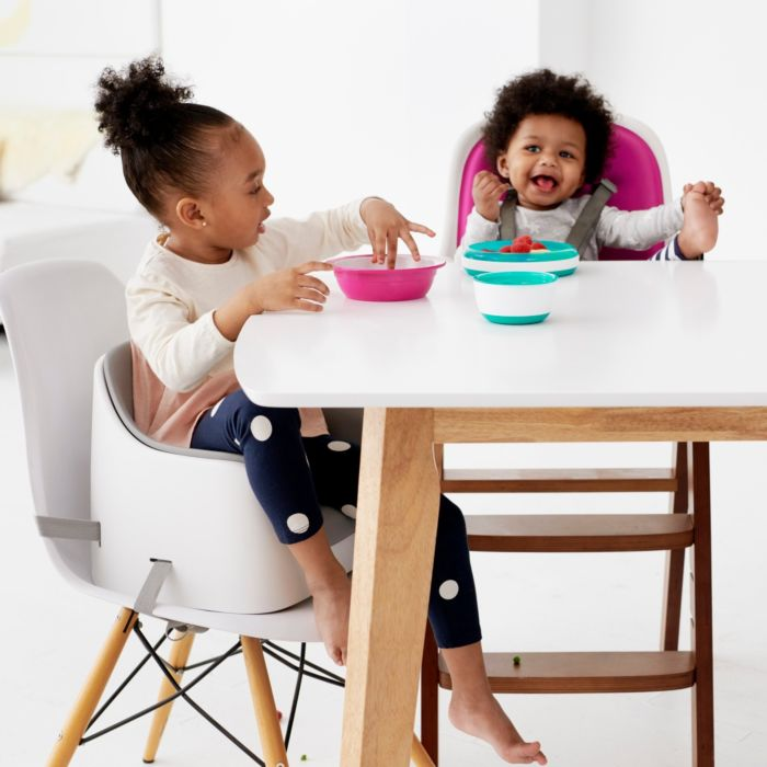 Kids sitting at table in OXO Tot Nest Booster Seats with Removable Cushions