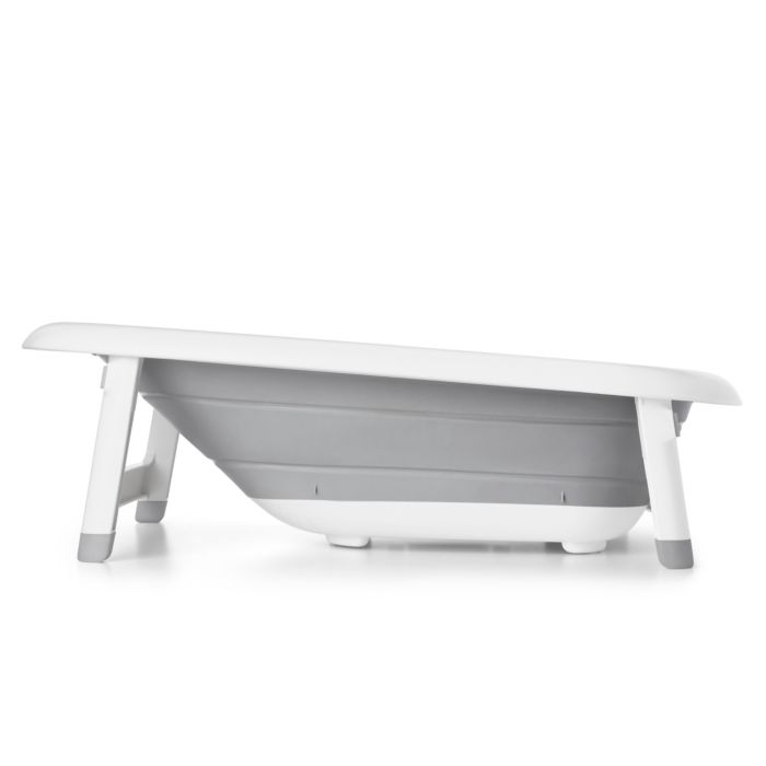 Side view of OXO Tot Splash & Store Bath Tub