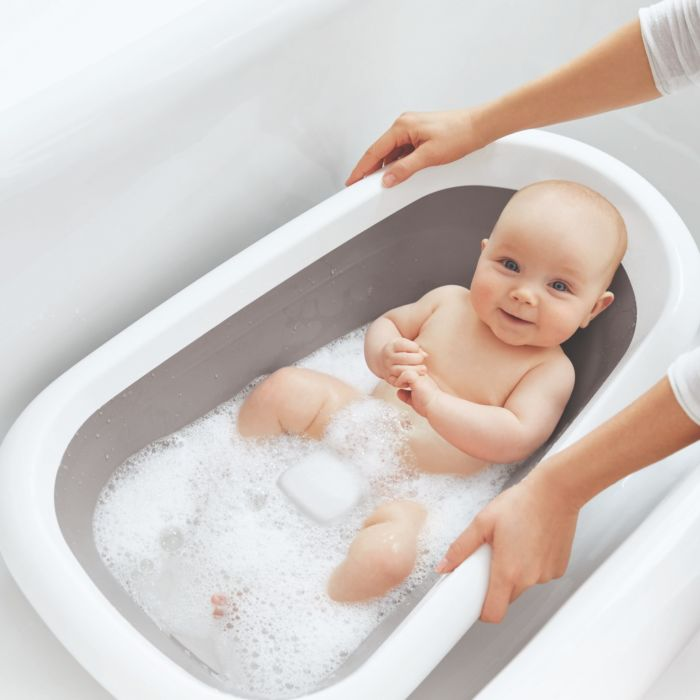 Infant in OXO Tot Splash & Store Bath Tub